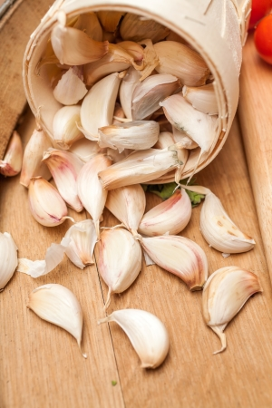 Organic garlic on old wood photo