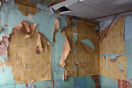 abandoned house: Old abandoned house with damaged wall upholstery