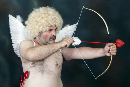 amore: Fat bearded mature hairy cupid with bow and heart arrow.