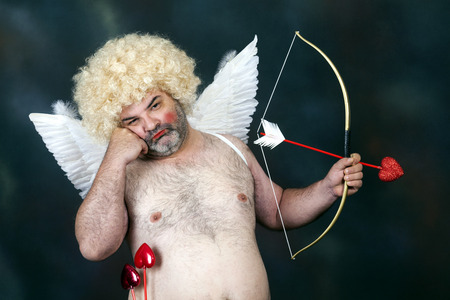 Fat bearded mature hairy cupid with bow and heart arrow. Thinking