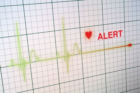 Flat line alert on a heart monitor. photo