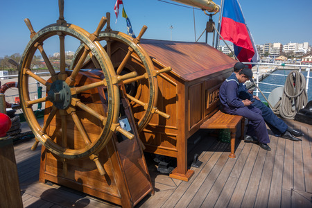 barque: ALEXANDROUPOLIS, GREECE - APR 18, 2015: Old Russias barque Kruzenshtern ex Padua, visit the port of Alexandroupolis. Crew in rest hour.
