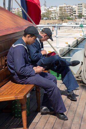 barque: ALEXANDROUPOLIS, GREECE - APR 18, 2015: Old Russias barque Kruzenshtern ex Padua, visit the port of Alexandroupolis. Crew in rest hour.