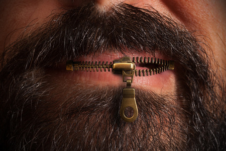 Beard man with zipped mouth