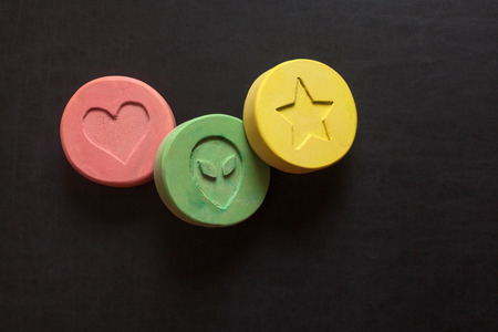 ecstasy: Ecstasy tablets on black background Stock Photo