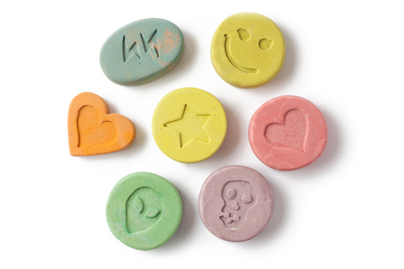 psychoactive: Ecstasy tablets on white background