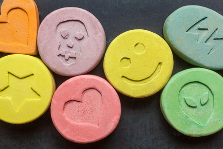 Ecstasy tablets on black background