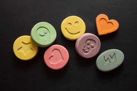 Ecstasy tablets on black background Stock Photo