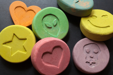 illicit: Ecstasy tablets on black background Stock Photo