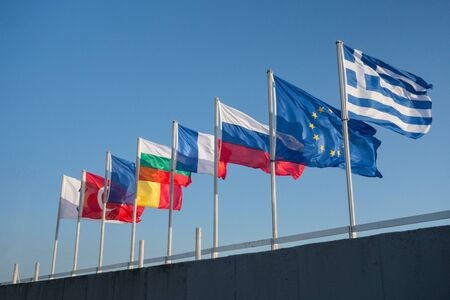 flagpoles: Flags of different countries are developing on the flagpoles