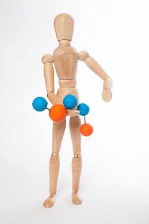 marioneta de madera: marioneta de madera con la molécula en el fondo blanco