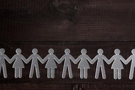 human chain: Human chain on black background