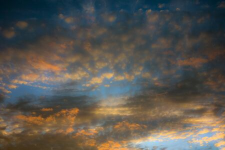 cloudy moody: Dramatic and moody pink, purple and blue cloudy sunset sky Stock Photo