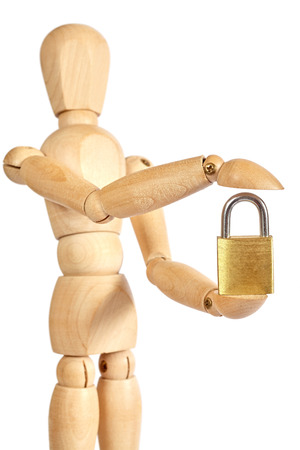 marioneta de madera: Wooden puppet holds small padlock on white background