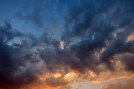 moody: Dramatic and moody pink, purple and blue cloudy sunset sky Stock Photo