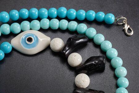 jewelery: Jewelery from beads on blackboard Stock Photo