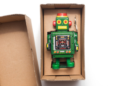 Robot in box on white background Stock Photo