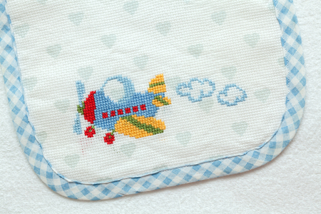 Embroidery with babys motifs. Airplane
