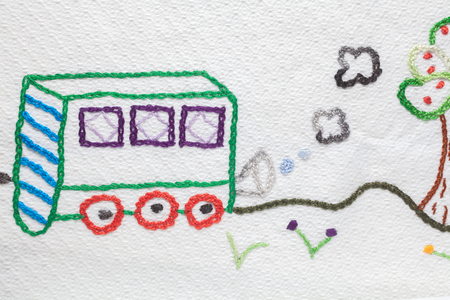 Embroidery with babys motifs. Train