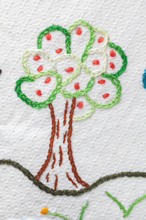 Embroidery with babys motifs. Apple tree with apples