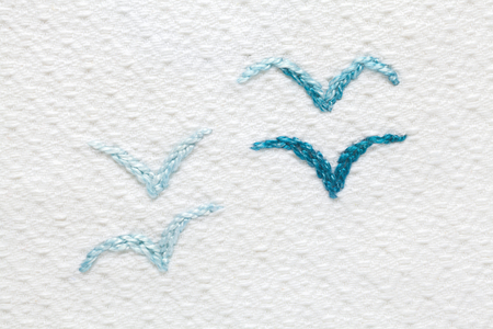 Embroidery with babys motifs. Four seagull