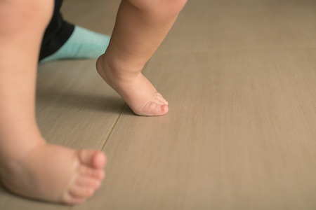 Childrens bare feet. Childs bare feet on the floor Stock Photo