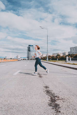 Girl runs across the road in the wrong place. dangerous pedestrian crossing