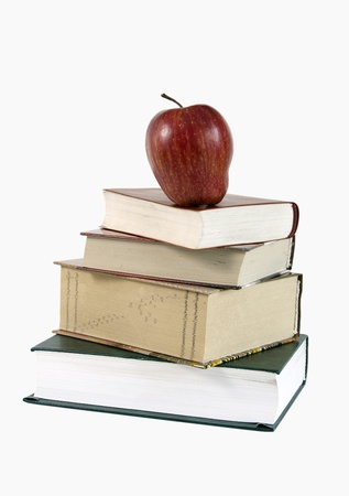 Education - an apple of the knowledges lies on books Stock Photo - 9363156