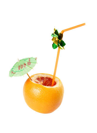 Fresh and juicy grapefruit  with pipes for drinking juice photo