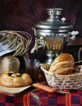 Still life with bread and a cup of tea photo