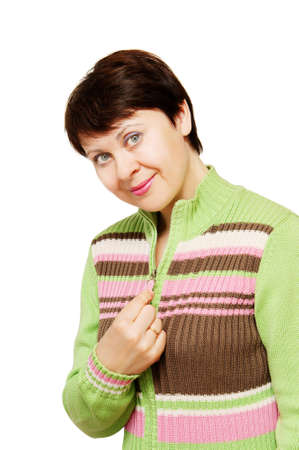 The young nice woman in a knitted jacket photo