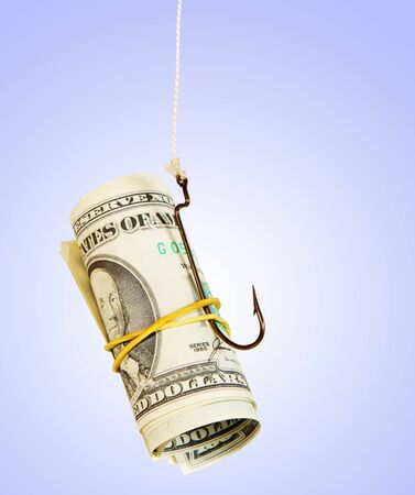 The concept. Dollars as a bait hang on a hook against the blue background