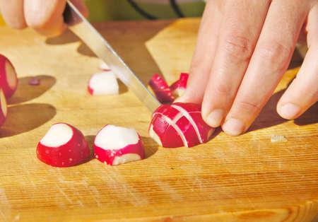 priming: Cutting of garden radish for salad
