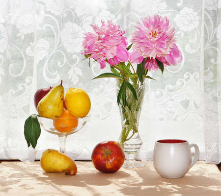 Still Life. Bouquet of peonies and fresh fruit in a vase on the table Stock Photo - 9800548