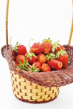 Full wicker basket of Strawberry isolated against the white background Stock Photo - 9885532