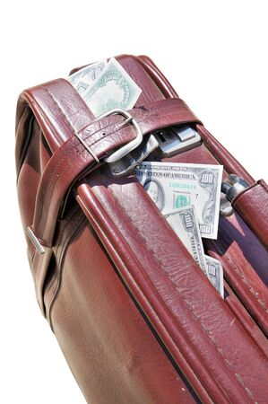 Dollars stick out of an old road bag Stock Photo - 10299876