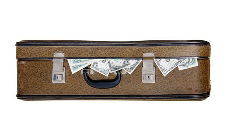 Dollars stick out of an old suitcase photo