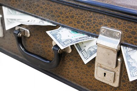 Dollars stick out of an old suitcase Stock Photo - 10299873