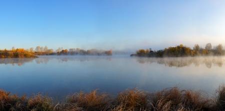 Beautiful autumn landscape on the lake photo