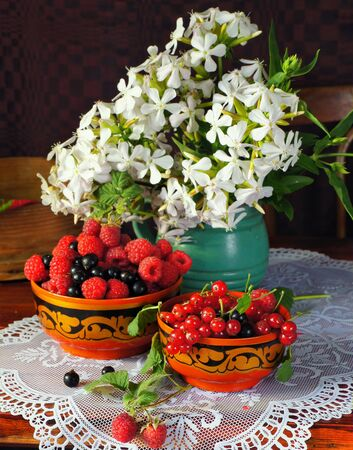 Still life with vaus Berry and white flowers Stock Photo - 10843532