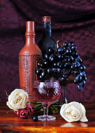 Classical still life with grapes and a wine bottles photo