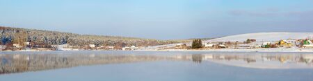 Winter landscape on lake in a sunny day Stock Photo - 11161742