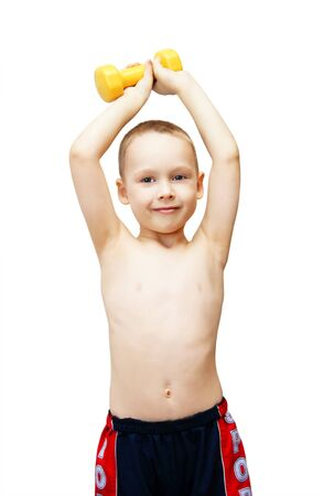 The little boy goes in for sports with dumbbells photo