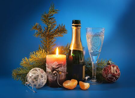 New Year still life with a candle and champagne photo