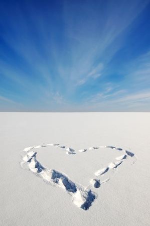 declaration of love: Heart on the snow Stock Photo