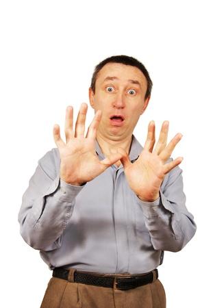 hombre asustado: hombre asustado se cierra con las manos Foto de archivo