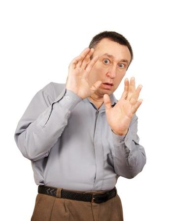 asustado: hombre asustado se cierra con las manos Foto de archivo