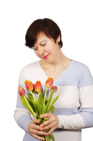 Woman holds a bouquet of tulips photo