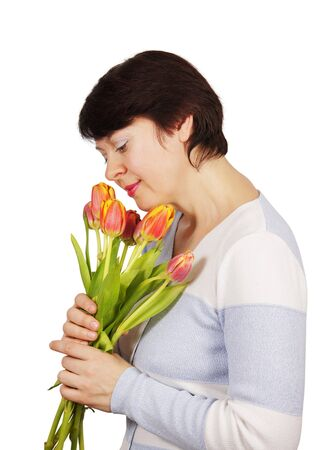 Woman with a bouquet of tulips photo