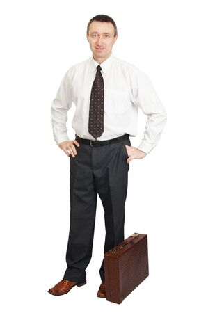 Man dressed in dark trousers and white shirt with suitcase Stock Photo - 12721775